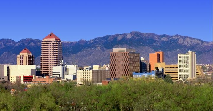 photograph of Downtown Albuquerque, New Mexico's skyline looking ENE toward the Sandia Mountains