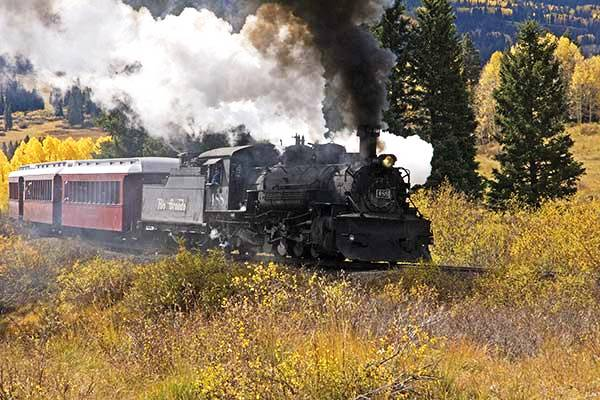 stock photo of Cumbres & Toltec train behind D&RGW locomotive #487 [built 1925] under full steam