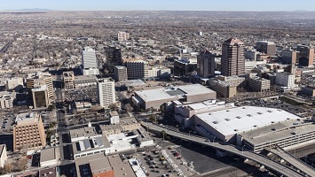 aerial view of Downtown Albuquerque, New mexico looking due West across the Rio Grande River winter-dull bosque